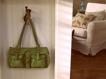 purse hanger. i definitely just put one of these in my place but it's way less cute...