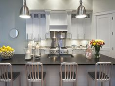 Transitional kitchen with silver pendant lights | 6873 il Regalo Circle, Naples, FL 34109