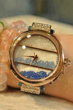 this is different and so beautiful. golden watch with blue details.