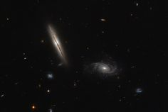 Despite its unassuming appearance, the edge-on spiral galaxy captured in the left half of this NASA/ESA Hubble Space Telescope image is actually quite remarkable. Located about one billion light-years away in the constellation of Eridanus, this striking galaxy — known as LO95 0313-192 — has a spiral shape similar to that of the Milky Way. http://www.spacetelescope.org/images/potw1604a/
