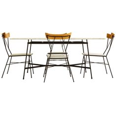 Paul McCobb Dining Set | From a unique collection of antique and modern dining room sets at http://www.1stdibs.com/furniture/tables/dining-room-sets/