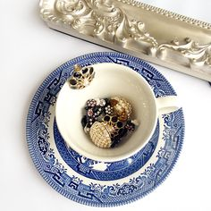 Bypass the garish 80's and go for vintage style clip ons with class! Lovely willow pattern tea cup and saucer and vintage jewellery