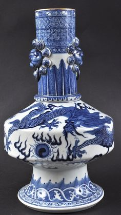 A CHINESE BLUE AND WHITE PORCELAIN VASE bearing Qianlong marks to base, of unusual form, painted with dragons. Minor rim wear. 12.75ins high.