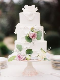Three tiered wedding cake with beautiful simple roses and leaves decorating. Photography: Erich McVey - erichmcvey.com  Read More: http://www.stylemepretty.com/2014/06/19/southern-garden-wedding-wrapped-in-elegance/