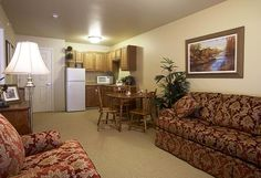 Get Cozy at Senior Apartments: Gorgeous Senior Apartments With Modern Sofas And Feather Pillows Also Round Dining Table Wood Dining Room Furniture Sets Along With Custom Kitchen Cabinet ~ surrealcoding.com Apartments Inspiration