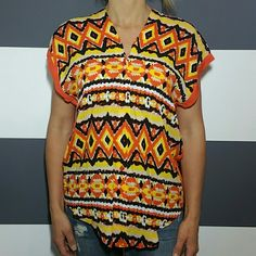 """Playful Aztex print top NWT Brand new with tags and extra buttons   Button down front top with fun color combination on front and solid orange on part of the back. Pair with jeans, leggings or shorts or a fabulous outfit!  100%rayon Size small Length at sides 22"""",length to points in front 28"""" Bust approx 20.5"""" side to side when laid flat  ❤Price is firm unless bundled ❤NO TRADES Tops Button Down Shirts"""