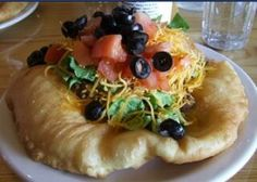 Navajo Fry Bread Recipe - Indian Fry Bread Recipe   Ingredients:  1 cup unbleached flour 1/4 teaspoon salt 1 teaspoon powdered milk 1 teaspoon baking powder 1/2 cup water Vegetable oil for frying Extra flour to flour your hands   Preparation:  Sift together the flour, salt, powdered milk, and baking powder into a large bowl. Pour the water over the flour mixture all at once and stir the dough with a fork until it starts to form one big clump.