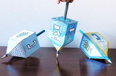 Color, cut and glue together this dreidel design then insert a pencil for a fun DIY game | alexbrands.com