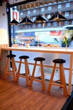 Counter, Lighting bar stools all designed by Liquidesign