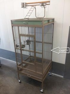 """Cage #11 – NOT AVAILABLE. 23""""x21""""x34"""" inside,   B/S ¾""""  , 64"""" to top of  playtop, light green, excellent condition - Has an extra grate and cage tray. Status - not available (went to ?????)"""