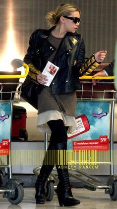 Airport style inspiration from Ashley Olsen. #fashion #leatherjacket #olsentwins