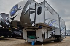 INCREDIBLE TOY HAULER!!!  2016 Lifestyle Tesla 3950 Reaching 43' in length, there is a massive 12' garage for all your toys! A private master bedroom holds a large bed, giant wardrobe and full bathroom! Sleeper sofas and a electric queen bed and loft with a half bathroom provide spots for family and guests to sleep! Cook in your stunning kitchen and relax on the huge recliner sofa! Shipping weight is 14,700 pounds.  Call our Tesla expert Mike Taravella 517-604-1908