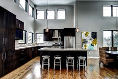 Varnish Wooden Kitchen Floor with Black Cabinet and Grey Wall