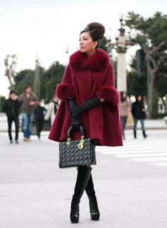"What: THE WHOLE OUTFIT  Where shall we start.... You have to love a vintage inspired look, starting with a swing coat, gloves.... yet it is so modern with the choice of colour and textures from the fur to the Leather, and not to forget the ""dont F*ck with me boots"" and some stunning gold hardware on a black bag."
