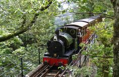 If the name, Great Little Trains of Wales, doesn't charm you all on its own, then a 9 mph, 14.5-mile round-trip ride on the adorable narrow gauge, coal-fired Talyllyn Railway certainly will. Staffed by volunteers, the historic train (locomotives and carriages date to 1865) steams its way through the verdant Fathew Valley from Tywyn on a route originally used to carry slate from the area's many mines.