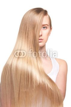Photo of young beautiful woman with long hair