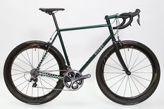 Jake Rusby has been busy: His workshop wall is filled with the diagrams of customer's frames that need to be out of the door before Christmas, and this green road bike with spotted tails is one that has just been completed. All Rusby Cycles are painted in-house, which is a service that was offered by…