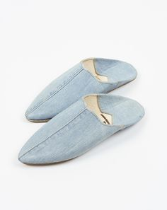 Denim slip-on from Brother Vellies. Made from repurposed denim. Pointed toe, top…