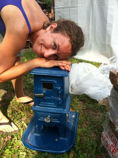 "Pix is building a tiny house and will use a wood stove for some of her heating. She's chosen a tiny stove from Salamander Stoves.    ""It weighs only maybe 40 lbs and sits upon its own cast iron base. It has a dial on the side for airflow and the whole thing is enameled a deep dynamic blue-teal color. It's truly the tiniest stove I think you can get for human use. I went to our wood pile and picked out the smallest pieces I could. They didn't fit. Actually only twigs were small enough..."""