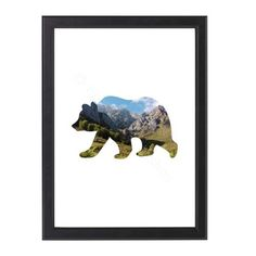 An unframed print featuring a bear silhouette made up of a mountain scene.