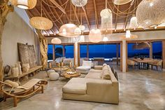 Stunning four-bedroom Villa Ixfalia will treat you to a seascape panorama and lush green hills surrounding the property. St Barts, Ibiza Fashion, Lamp Light, Villa, Ceiling Lights, Vacation, Table Decorations, Eden Rock, Luxury