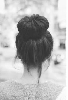 Love this sock bun hair bun! So stylish with the pieces of hair out in the front of her head! Also love doing this to my hair to! ✔