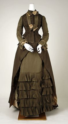 Dress, two shades of olive green with tan trim.  Date: ca. 1880 Culture: American Medium: silk  Metropolitan Museum of Art  Accession Number: 39.83.2a, b