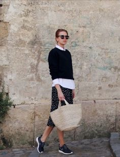 Cropped jumper over white button-down with polka dot skirt.