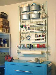 As shown here, hook racks were incorporated into the design of the display unit. This is a nice way to hang scissors, tape and ribbon.