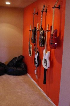 guitars on wall in spar room