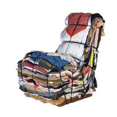 Design by Tejo Remy, By Droog. The Rag Chair is serious about recycling. Layered from the contents of 15 bags of rags, the Rag Chair reuses clothes that would otherwise be thrown out. The Rag Chair. Contemporary Chairs, Modern Chairs, Contemporary Design, Reuse Clothes, Old Clothes, Winter Clothes, Recycled Furniture, Modern Furniture, Furniture Design