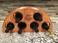 Reclaimed wine barrel head wine rack