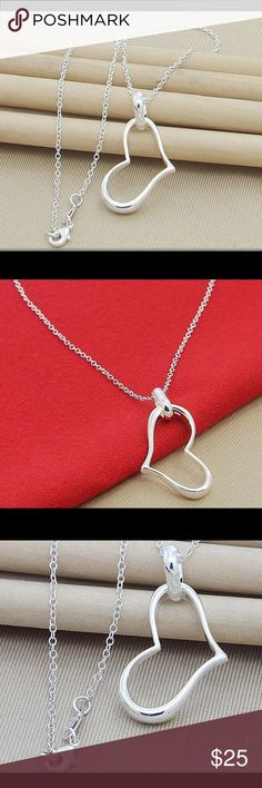 """❤️ STERLING SILVER (925) DANGLING HEART NECKLACE ❤️ This is a beautiful Sterling silver (925) dangling heart necklace. It is substantial in weight. The chain measures: 18""""L. The heart measures: 1 1/8""""L X 1/2""""W X 3/16""""D. Jewelry Necklaces"""