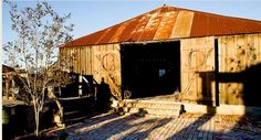 """Looking to have a """"kick up your heels"""" good time type of wedding? Then look no further than Marburger Farm. Located in historic Round Top, TX., Marburger Farm is nestled on 43 acres of rolling pastureland. Twelve historic buildings are available for your Texas wedding including a Dance Hall, Bingo Hall and Saloon!"""