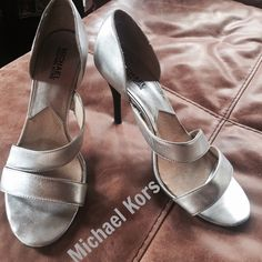 Michael Kors heels Size 8 silver heels very comfortable . worn but still in good shape leather with leather sole heel is 3 1/2 inches MICHAEL Michael Kors Shoes Heels