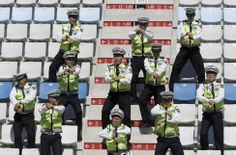 South Korean Police perform the Gangnam style dance in the grandstand ahead of the Korean Formula One Grand Prix at the Korean International Circuit in Yeongam. (AP)