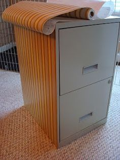Contact paper on file cabinet. I'm going to try something similar to this on the file cabinet I just picked up today! :)