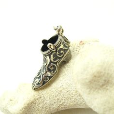 Beautiful ornate sterling silver boot shoe charm. Diamond cutting adds some sparkle. Spring ring clasp makes it easy to attach to any charm bracelet or necklace. Age unknown, signed with Carolyn Polla