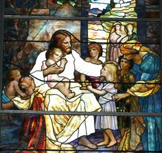 Stained glass windows present in churches depict the life and teaching of Jesus Christ,