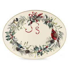 Dress up your favorites in holiday style this season with the Lenox Winter Greet Platter - 16 in. This generously sized platter is perfect for a variety of uses and is conveniently dishwasher-safe. Made of ivory bone china, this platter features a natural winter bird and greenery pattern created by artist Catherine McClung and is accented in 24 karat gold.