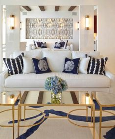 Coastal Living Room with Gold Mirrored Coffee Table. Featured on Completely Coastal.