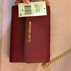 NWT Michael Kors Jet Set Travel bag (last price) NWT Michael Kors Jet Set Travel LG Phone Crossbody Leather. Color : Cherry. I have too many bags. Decided to clear this one out. In great condition Michael Kors Bags Crossbody Bags
