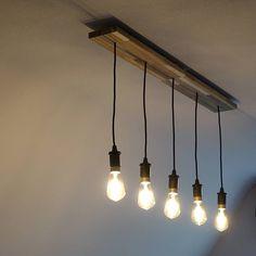 I turned this cheap Ikea SKOGSTA cutting board into a sleek floating light fixture. I combined it with 5 of the dimmeable Ikea LUNNOM bulbs. #ikea #ikeahacker #lunnom #skogsta #reclaimedwood #diy #makersmemo #lightbulb #light #interiordesign #interior