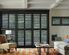 Defining American luxury through American quality, with the impeccable craftsmanship of Heritance® hardwood shutters handcrafted series by Hunter Douglas, a producer of custom products made in the USA.  #WndowTreatments #LivingRoom