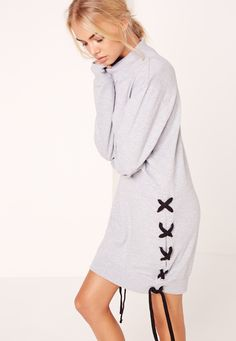 Get tied up in this sweatshirt dress, featuring an oversized style and contrast lace up side and sleeves for a chilled out look.