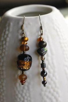 Inspired by our scenic Canadian landscapes, mismatch earrings made with Artisan beads... earthy browns, copper, bronze, and golds. All are beautiful and some handcrafted lampwork beads. These long earrings dangle pendulum style. Nickel free antiqued brass earring wires. Gorgeous earrings to commemorate Canadas 150 Birthday, gift a Gardener or to celebrate Earth Day perhaps. Gift Packaging... - Receive your earrings in a muslin pouch, or an organza bag with satin drawstrings or gift your… Statement Earrings, Dangle Earrings, Copper, Brass, Fall Jewelry, Organza Bags, Gift Packaging, Lampwork Beads, Earthy