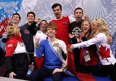 Canada Wins Silver In Team Figure Skating At 2014 Olympics. ----->>  SOCHI, RUSSIA - FEBRUARY 09: Kevin Reynolds of Canada reacts with teammates and coaches while waiting for his score in the Men's Figure Skating Men's Free Skate during day two of the Sochi 2014 Winter Olympics at Iceberg Skating Palace (Photo by Darren Cummings/Pool/Getty Images) (Sochi 2014 - Canadian Olympics)