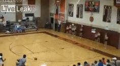 Basketball player nails shot of a lifetime as he runs out the door.