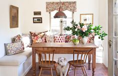 cozy banquette with rustic farmhouse table
