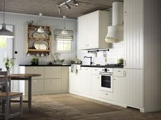 IKEA An off-white country kitchen with black worktops. Combined with off-white oven and extractor hood. Off White Kitchen Cabinets, White Ikea Kitchen, Off White Kitchens, White Cabinets, Home Kitchens, Ikea Kitchens, Ivory Kitchen, Cream Cabinets, Kitchen Black